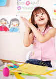 Child glue paper in preschool. Child care. Little girl glue paper in preschool. Child care Royalty Free Stock Photo