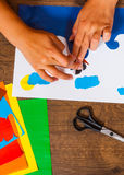 Kids art. Crafts concept. Handmade. on wooden table top view. Child Glues of paper. Sheets of colored paper. Kids art. Crafts concept. Handmade. on wooden table royalty free stock photos
