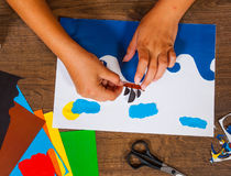Kids art. Crafts concept. Handmade. on wooden table top view. Child Glues of paper. Sheets of colored paper. Kids art. Crafts concept. Handmade. on wooden table royalty free stock photo