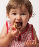Child gluttony for chocolate food Royalty Free Stock Photography