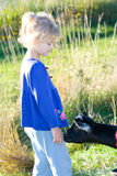 Child and goat. Stock Photos