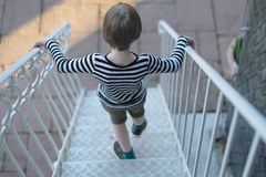 The child. Goes down the metal stairs royalty free stock photos