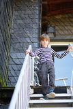 The child. Goes down the metal stairs royalty free stock photo
