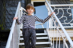 The child. Goes down the metal stairs royalty free stock image