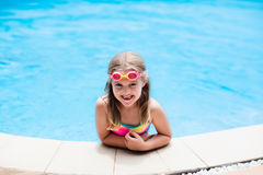 Child with goggles in swimming pool. Kids swim. Royalty Free Stock Image
