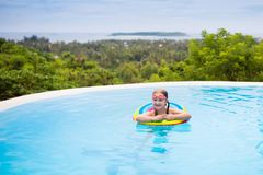 Child with goggles in swimming pool. Kids swim. Royalty Free Stock Images