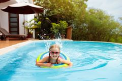 Child in swimming pool. Kids swim. Water play royalty free stock photos