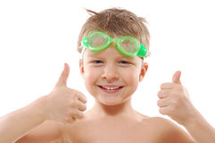 Child with goggles and thumbs up. Smiling elementary 5 year old  boy with wet hair,  goggles and thumbs up over white Stock Photography