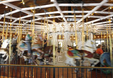 Child going round in circles on carousel with motion blur Stock Photography