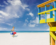 Child going to the beach in Miami stock photos