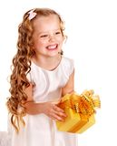 Child with gold gift box on birthday. Isolated Stock Images