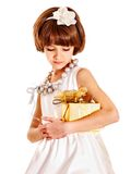 Child with gold gift box on birthday. Isolated Royalty Free Stock Image