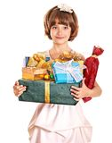 Child with gold gift box on birthday. Stock Image