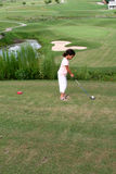 Child Golfing. On Course stock photography