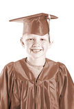 Child Graduate in Cap and Gown Stock Photo