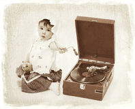 Child with gramophone. Vintage like old photo of child with gramophone Stock Photos