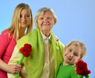 Child and grandchild with senior woman. Stock Photo