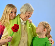Child and grandchild with senior woman. Stock Photos