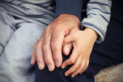 Child and grandfather Stock Images