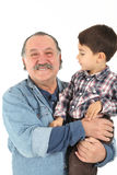 Child and grandfather playing royalty free stock photo