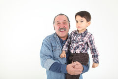 Child and grandfather playing stock photo