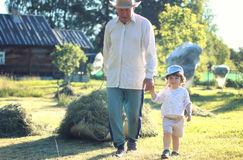 Child and grandfather rural field Stock Photography