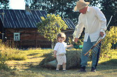 Child and grandfather rural field Royalty Free Stock Photo