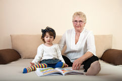 Child and grandma with coloring book Royalty Free Stock Photos