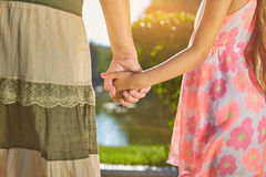 Child with grandma holding hands. Stock Images