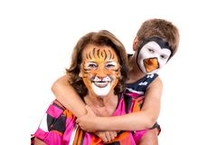 Kid and granny with face-paint royalty free stock photo