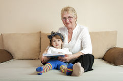 Child grandmother coloring book sofa Stock Photography
