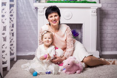 Child and grandmother with Easter eggs Royalty Free Stock Photos