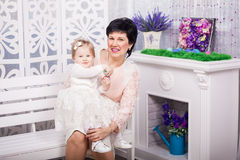 Child and grandmother with Easter eggs Stock Photos