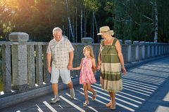 Child and grandparents holding hands. royalty free stock image
