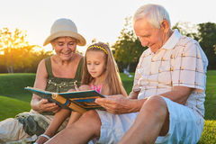 Child with grandparents, photo album. royalty free stock photo