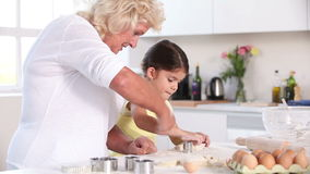 Child and granny preparing pastry stock video footage