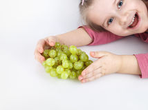 Child and grapes Stock Images