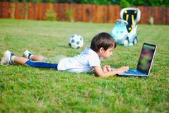 Child on the grass royalty free stock photos