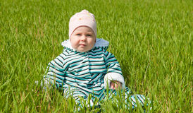 Child on grass Stock Photos