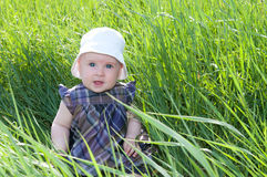 Child on grass Royalty Free Stock Images