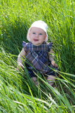 Child on grass Royalty Free Stock Image