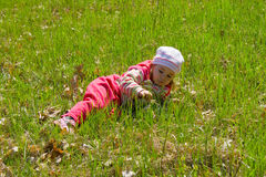 Child on grass. Little child laying on the green grass Stock Image
