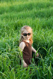 The child in a grass. The child in a high marsh grass Royalty Free Stock Image