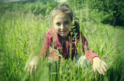 Child on the grass royalty free stock images