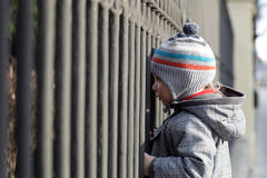 Child and grating Royalty Free Stock Photo