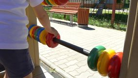 Child with a great pleasure finds the rings on the playground. Slow motion stock video footage