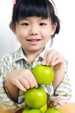 Child with green apple Royalty Free Stock Photo
