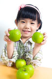 Child with green apple Royalty Free Stock Photos