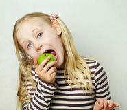 Child with green apple Royalty Free Stock Image