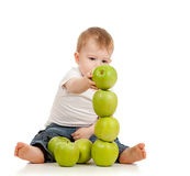 Child with green apples over white Stock Photography